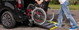 wheelchair entering a taxi